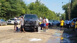 Keith Band Director and Band Members Washing Cars During a Fundraiser